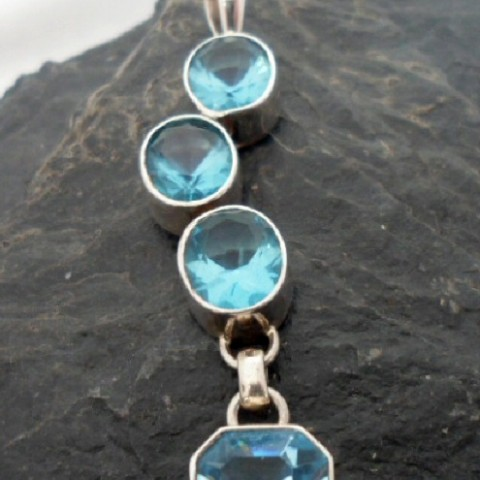 Sterling Silver Journey Pendant with Four Blue Topaz Gemstones