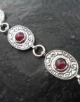 Sterling Silver Fleur-de-lis Medallion Garnet Bracelet