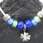 Sterling Silver Bracelet with 9 Silver Charms and Glass Beads