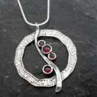 Sterling Silver Journey Circle of Love Garnet Necklace