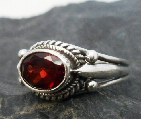 "Details: ---Size-6 and 8 ---shank and band measures .15"" wide flaring out to .33"" wide at the top ---one large oval faceted Red Garnet Cabochon measures .33"" long by .25"" wide and is .25"" deep ---.925 sterling silver ---quantity 2 Sterling Silver Designer Garnet Ring"