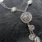 Shimmering Rhodium Plated Sterling Silver Swirl Necklace