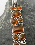 Long Sterling Silver Pendant with 11 Baltic Amber Cabochons